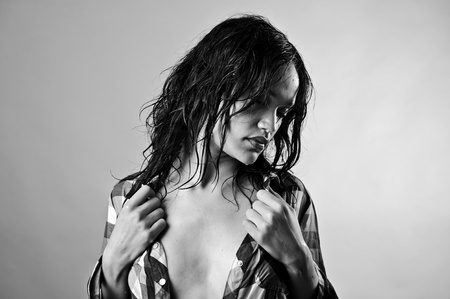 Alluring wet fashion model takes her top off photo