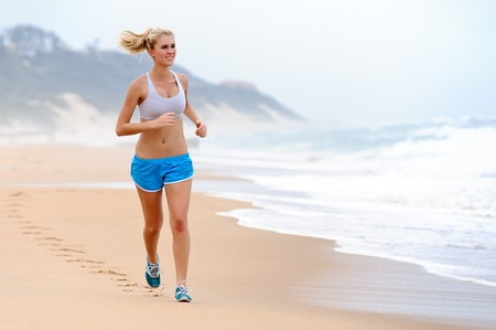 Young blond female runs along the beach Stock Photo - 8726952
