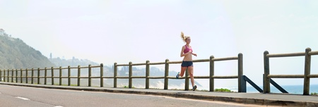 outdoor fitness: Happy fitness running girl outdoors at the beach.