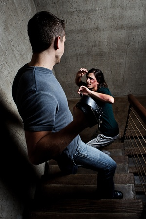 life partners: Conceptual shoot of a woman being abused by her partner  Stock Photo