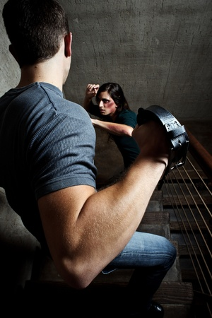 battered woman: Conceptual shoot of a woman being abused by her partner  Stock Photo