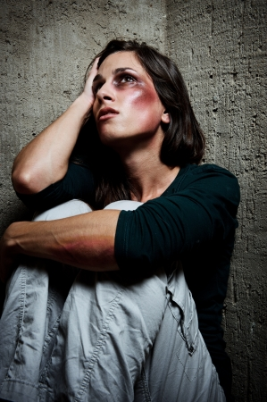 Abused woman wondering why her loved one would hurt her in this way  photo