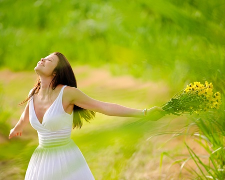 smiling woman: Carefree adorable girl with arms out in field. summer freedom andjoy concept.