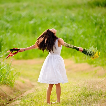 Happy woman is free and enjoys the spring sunlight photo
