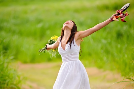 Carefree girl is happy in field with flowers photo