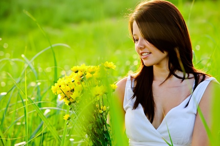 gorgeous attractive girl win field with flowers, candid summer concept Stock Photo - 8726275