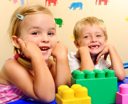 Happy children posing at kindergarten with big smiles photo