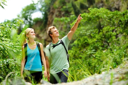 cute couple have fun together outdoors on a hike Stock Photo - 8930036