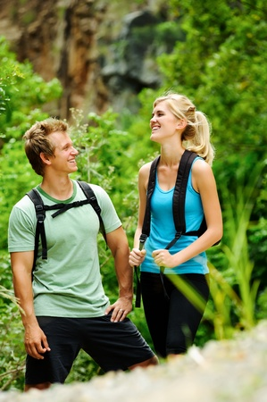 cute couple have fun together outdoors on a hike photo