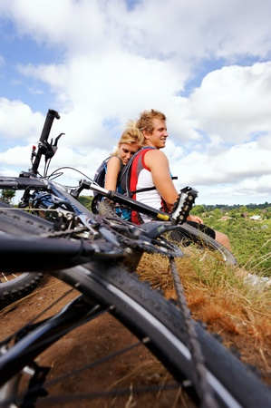 Happy mountainbike couple outdoors have fun together on a summer afternoon Stock Photo - 8929983