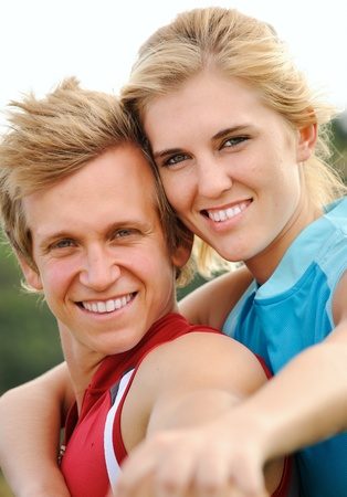beautiful couple posing together for a happy portrait outdoors together photo