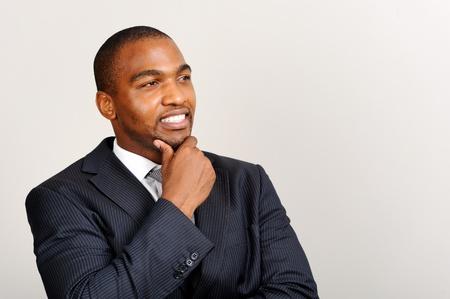 contemplates: Young attractive African executive contemplates his next move