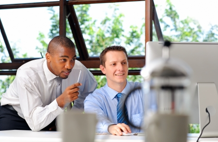 African businessman mentors his white associate on how to deal with customers effectively photo
