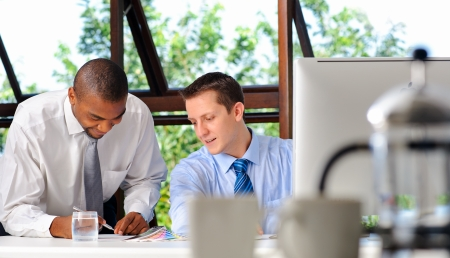 Two business partners has a meeting to discuss the current market situation  Stock Photo - 9967690