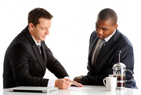 Two businessmen of different ethnicity discuss about their project photo