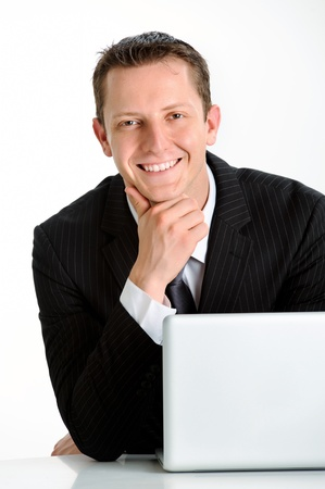 approachable: Young caucasian man in business suit smiles for a portrait