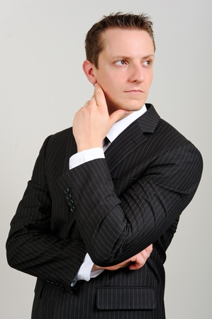 Attractive white executive is thinking  photo