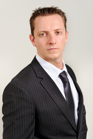Attractive white executive has a serious expression photo
