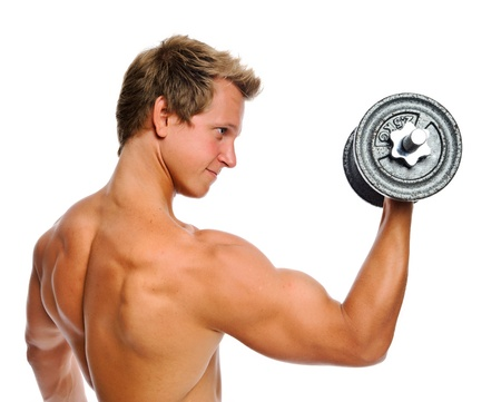 body built: Bare chested athelete doing bicep exercises in studio   Stock Photo