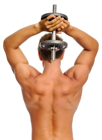 exertion: Well toned man lifts dumbbells for tricep exercise