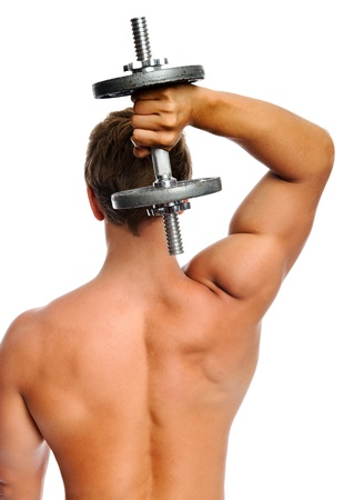 Well toned man lifts dumbbells for tricep exercise  photo