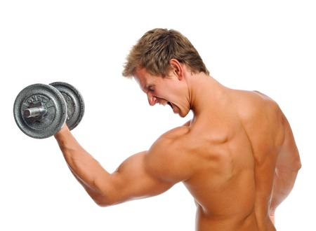 body built: Bare chested fitness buff doing bicep exercises isolated on white Stock Photo