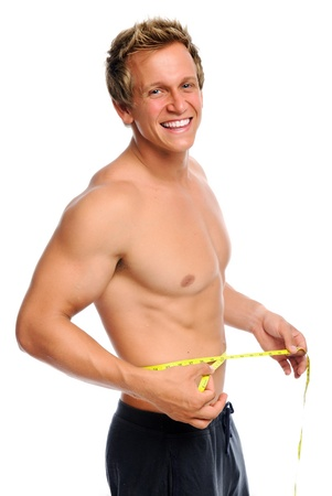 body built: Man is happy with new waist line measurement  Stock Photo