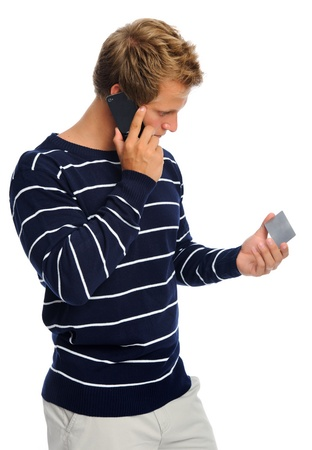 Well groomed man using his credit card for e-commerce  Stock Photo - 9967665
