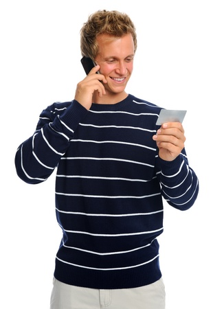 Man on phone talking to representative while holding his credit card photo