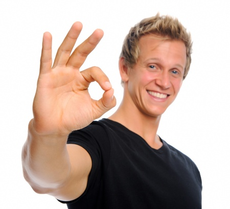 alright: Happy friendly man making an OK gesture  Stock Photo