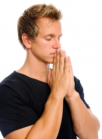 clasps: Blonde man clasps his palms together in prayer, isolated on white