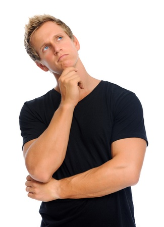 visualise: Guy in black t-shirt is deep in thought, isolated on white  Stock Photo