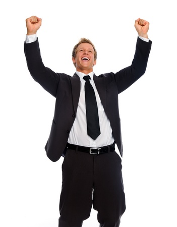 Successful businessan clenches fists in victory gesture photo