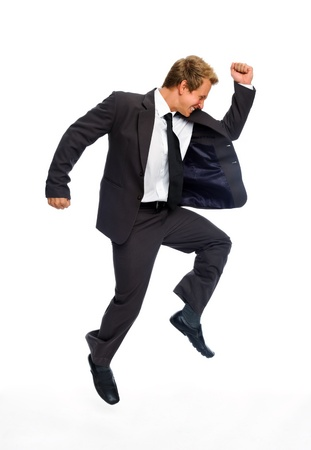 Excited man in business suit jumps in victory and joy, isolated on white photo