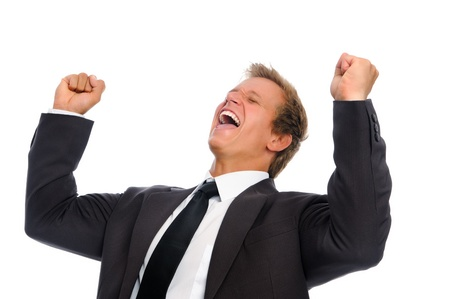 Attractive man in formal suit achieves success and is overjoyed  photo