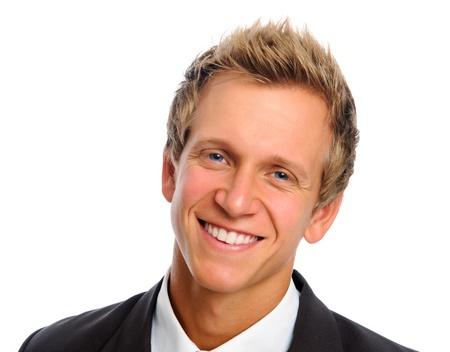 Heureuse personne morale souriant en costume noir business, isolé sur fond blanc  Banque d'images