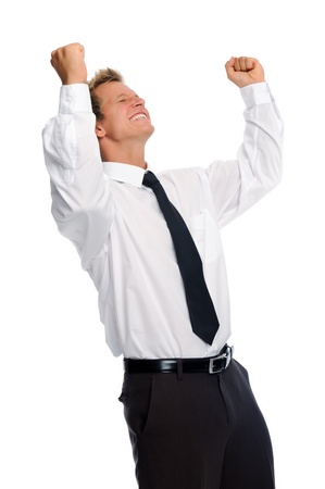 overjoyed: Attractive white businessman is overjoyed and raises his arms in victory; isolated on white