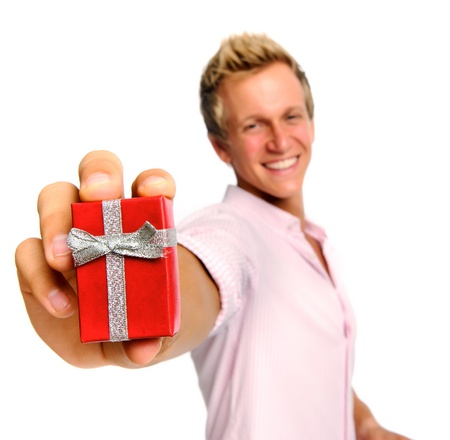 Happy blonde man holding a present for valentines day; selective focus on box Stock Photo - 9967599