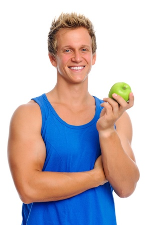 canottiera: Attractive blond man in sportswear holding a green apple; healthy eating concept