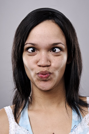 squint: A real funny face captured in high detail (see portfolio for more in this series)  Stock Photo