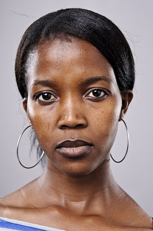 woman face close up: Real beautiful black woman portrait in studio