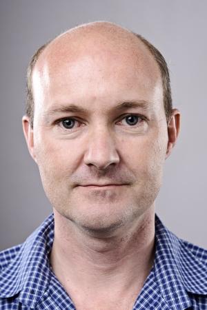 normal: Normal bald man poses for portrait in studio