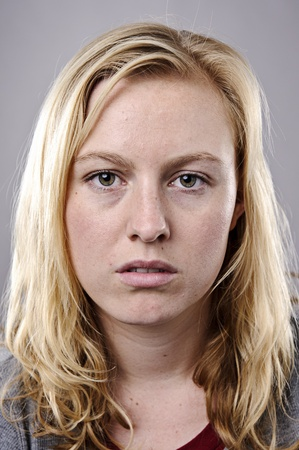 Young blonde woman poses for fine art portrait photo