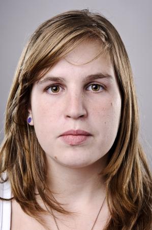 female portrait: Beautiful portrait or a young brunette girl in studio