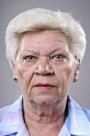 mean: Angry old woman stares at camera, high quality, must see full size