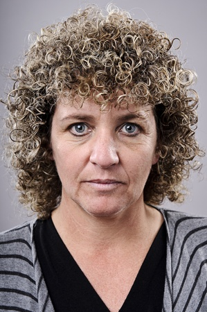 wrinlked lady with a crazy perm afro hairstyle photo
