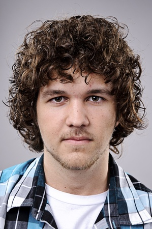 Detailed portrait of a young caucasian guy with curly hair Stock Photo - 10142325
