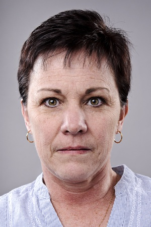 women face stare: Brunette older woman portrait, high detail, wrinkles and blemishes