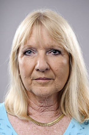 wrinkly: wrinkled blonde woman poses for a portrait in studio