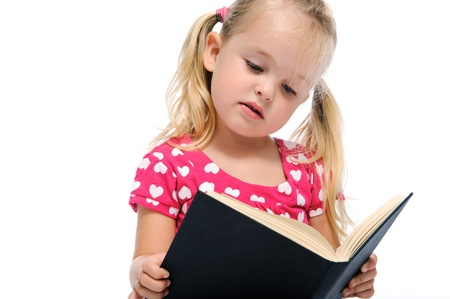 plait: young preschool child learns while reading a book, isolated on white